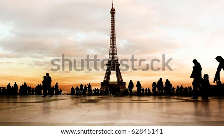 Beautiful soft-colored sky at dusk behind the Eiffel Tower in Paris. - stock photo