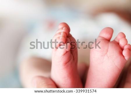 Beautiful Soft newborn baby feet close up - stock photo