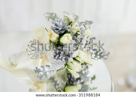 Beautiful soft pastel bridal bouquet on a glass table for the wedding ceremony