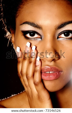 beautiful South girl hiding behind Pigtails - stock photo