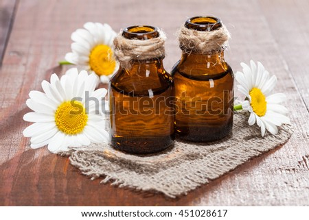 Beautiful spa and bodycare composition of fresh camomile flowers and organic oils