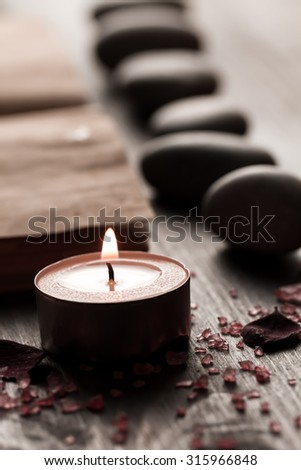 Beautiful Spa composition with aroma candles and empty vintage open book on wooden background. Treatment, aromatherapy - stock photo