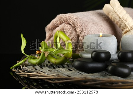 Beautiful spa composition with bamboo on dark background - stock photo