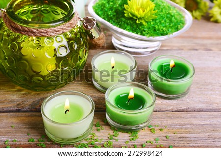 Beautiful spa composition with candles on table close up - stock photo