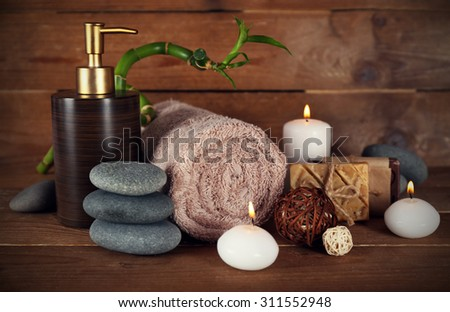 Beautiful spa composition with candles on wooden background - stock photo