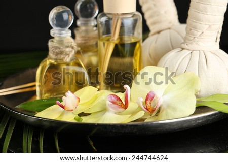 Beautiful spa composition with orchid on dark background - stock photo