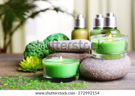 Beautiful spa composition with spa stones and candles on fabric background - stock photo