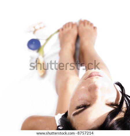 Beautiful spa girl isolated with beauty elements on her feet