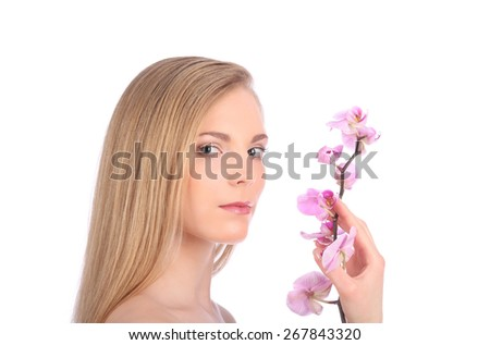 Beautiful Spa Girl With Orchid Flowers Skincare concept studio - stock photo