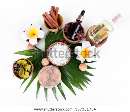 Beautiful spa setting on palm leaf, isolated on white - stock photo