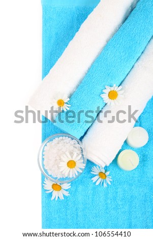 Beautiful spa setting with daisies and sea salt isolated on white