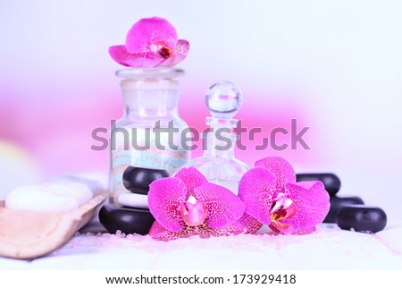 Beautiful spa setting with orchid on white wooden table on bright background