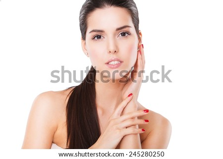 Beautiful Spa Woman Touching her Face. Perfect Fresh Skin. Pure Beauty Model. Youth and Skin Care Concept - stock photo