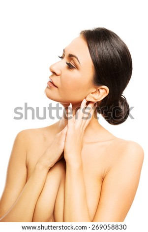 Beautiful spa woman touching her neck.