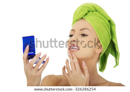 Beautiful spa woman with a mirror. - stock photo