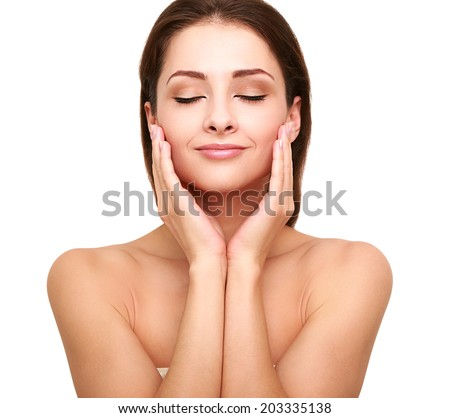 Beautiful spa woman with clean beauty skin touching her face with closed eyes. Beauty natural model - stock photo