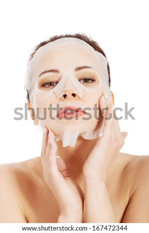 Beautiful spa woman with collagen mask. Isolated on white.