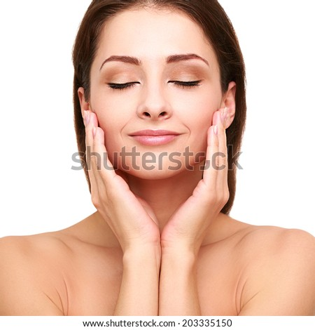 Beautiful spa young woman touching her clean perfect skin. Isolated closeup portrait - stock photo