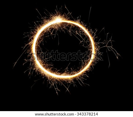 Beautiful sparkle sparklers in a circle on a black background. High resolution.