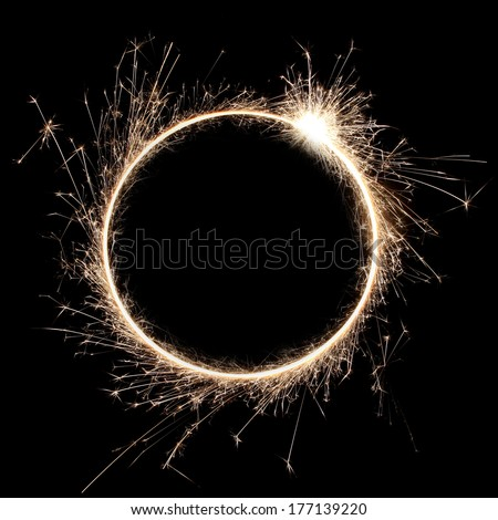 beautiful sparkler in a circle on a black background - stock photo