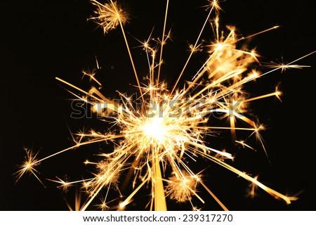 Beautiful sparkler on dark background, close up - stock photo