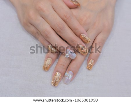 Beautiful Sparkling Pink Gold Gritter And Silver Gel Acrylic Nail Art Design With Cute Peal Ribbon