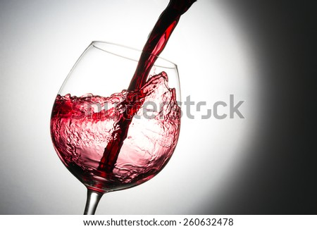 Beautiful splash of red wine - stock photo