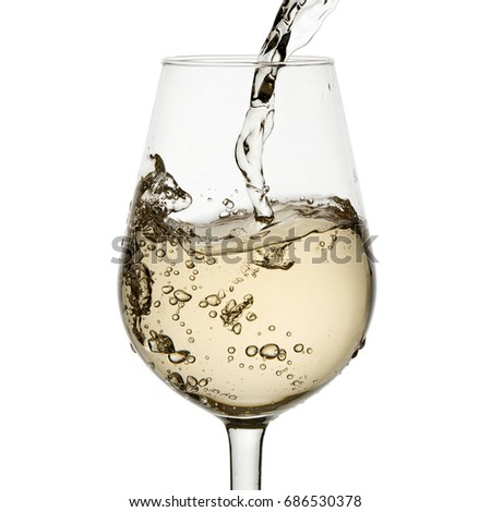 Beautiful splash of wine in a glass on a white background