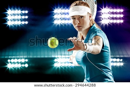 Beautiful sport woman tennis player with a racket in blue costume - stock photo