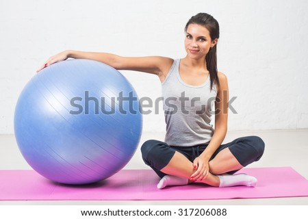 Beautiful sport woman with a fitness ball. Pilates, sports, health - stock photo