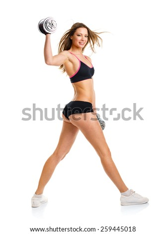 Beautiful sport woman with dumbbells doing sport exercise, isolated on white background - stock photo
