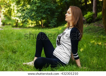 beautiful sports girl does exercises in the park. The concept of sport and health