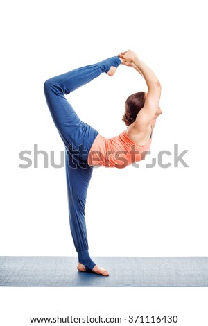 Beautiful sporty fit woman doing yoga asana Natarajasana - Lord of the dance pose advanced variation isolated on white - stock photo