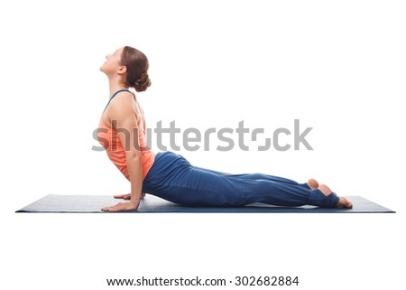 Beautiful sporty fit yogini woman practices yoga asana urdhva mukha svanasana - upward facing dog pose isolated on white - stock photo