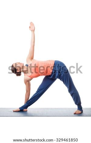 Beautiful sporty fit yogini woman practices yoga asana utthita trikonasana - extended triangle pose isolated on white background - stock photo