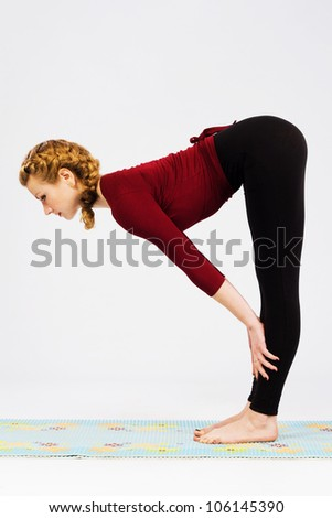 Beautiful sporty woman doing stretching exercise - stock photo