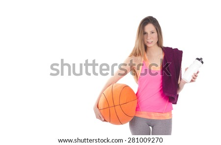Beautiful sporty woman holding a basketball against a white background - stock photo
