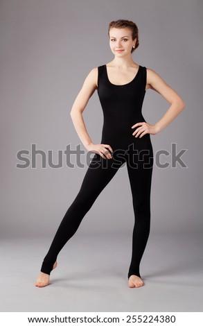 Beautiful sporty woman in black tights - stock photo