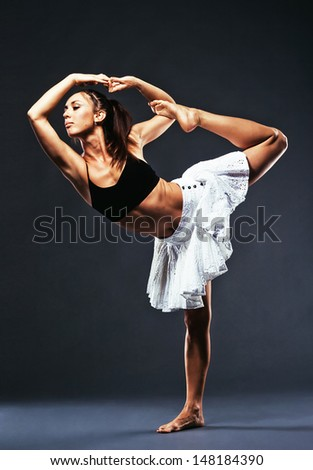 Beautiful sporty woman is working out - stock photo
