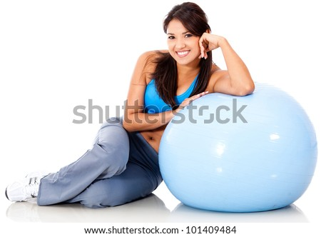 Beautiful sporty woman with a Swiss ball - isolated over white - stock photo