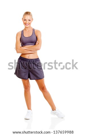 beautiful sporty woman with arms folded isolated on white background