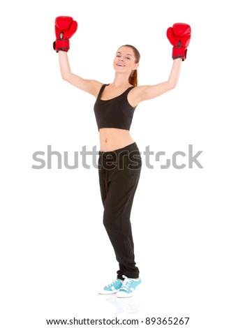 Beautiful sporty woman with boxing gloves on white