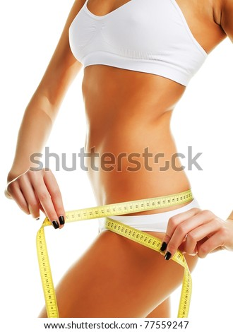 Beautiful sporty woman with yellow measure around body on white background - stock photo