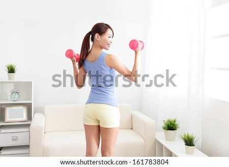beautiful sporty woman working out with two dumbbells , asian beauty model - stock photo