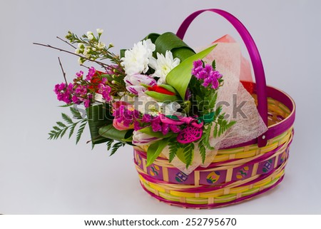 Beautiful spring bouquet in Easter basket. - stock photo