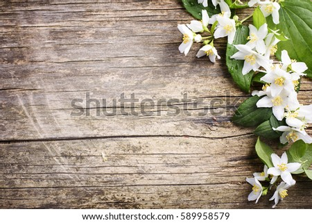 Beautiful Spring Flower Border On Rustic Wooden Background With Copyspace White Jasmine Bouquet Arrangement For