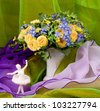 Beautiful spring flowers in a glass vase and ballet-dancer - stock photo