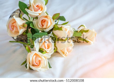Beautiful spring flowers in a glass vase background of wedding party