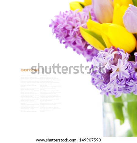 Beautiful spring flowers in vase over white (with easy removable sample text) - stock photo