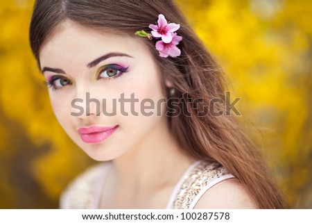 Beautiful Spring Girl with flowers - stock photo